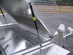 There's a gas assist lift on all our barbecue trailer grills
