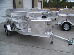 Front view of barbecue grill trailer with storage box