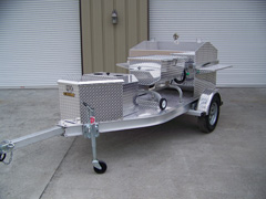 Side view of barbecue grill trailer with storage box