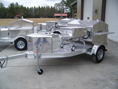 Barbecue grill trailer with oyster steamer
