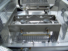 Two burner stainless stove on barbecue trailer grill